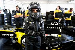 Aseel Al-Hamad, prepares to drive a 2012 Lotus E20 Renault F1 car in the Renault Passion Parade