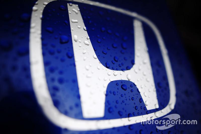 Rain water on a Honda badge belonging to a Toro Rosso STR13