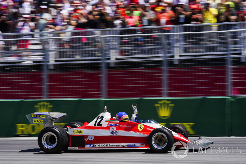 Jacques Villeneuve drives the Ferrari 312T3 raced by his father Gilles Villeneuve on a parade lap