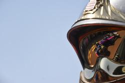 Pierre Gasly, Scuderia Toro Rosso STR13 reflected in a fireman helmet