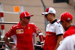 Kimi Raikkonen, Ferrari, and Marcus Ericsson, Sauber