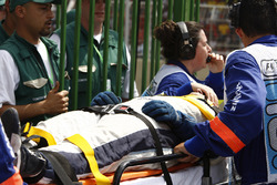 A Williams mechanic is stretchered away after being hit by Kazuki Nakajima, Williams FW29 during a p