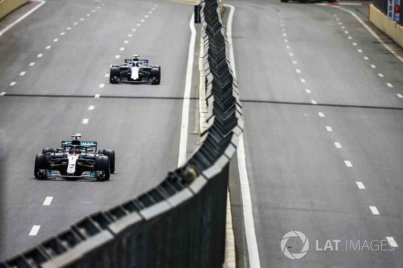 Lewis Hamilton, Mercedes AMG F1 W09, leads Lance Stroll, Williams FW41 Mercedes