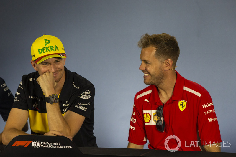 Nico Hulkenberg, Renault Sport F1 Team and Sebastian Vettel, Ferrari in the Press Conference