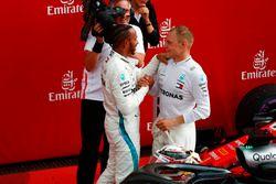 Lewis Hamilton, Mercedes AMG F1, is congratulated by Valtteri Bottas, Mercedes AMG F1