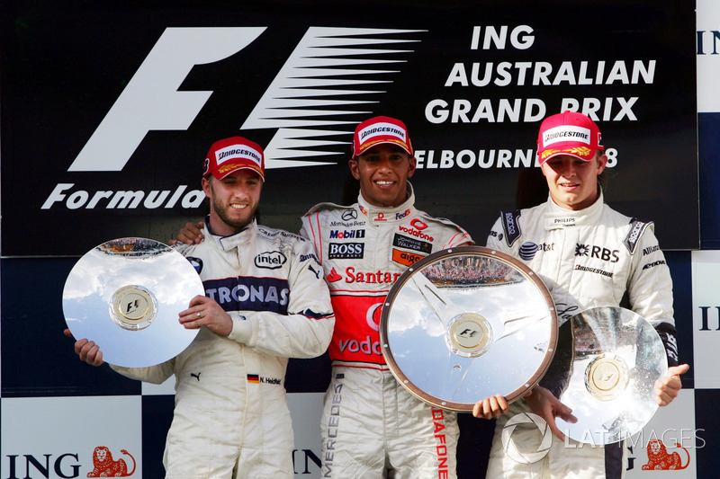 Podium: second place Nick Heidfeld, BMW Sauber F1, Race winner Lewis Hamilton, McLaren, second place