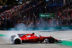Sebastian Vettel, Ferrari SF70H, performs doughnuts as he returns to the pits after winning the race