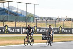 Guy Martin, and Jenson Button, McLaren cycle the track