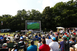 Fans gather around a screen for the England v Sweden World Cup game