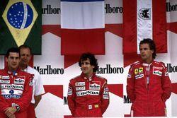 Podium: race winner Alain Prost, McLaren, second place Ayrton Senna, McLaren, third place Gerhard Be
