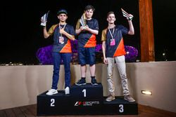 Brendon Leigh celebrates on the podium after winning the E-Sports event