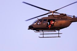 A Bell 407 of the UAE Armed Forces with Mark Sutton, F1 Photographer
