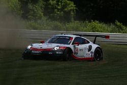 #912 Porsche Team North America Porsche 911 RSR, GTLM: Laurens Vanthoor, Earl Bamber runs wide at Turn 1