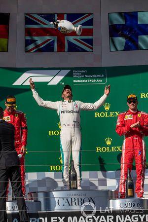 Sebastian Vettel, Ferrari, Lewis Hamilton, Mercedes-AMG F1 and Kimi Raikkonen, Ferrari celebrate on the podium