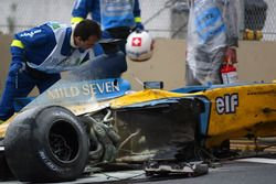 Medical staff attend to Fernando Alonso, Renault F1 Team trackside