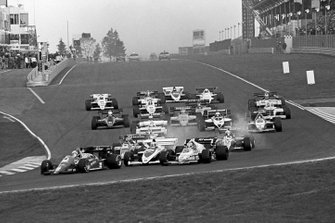 Ayrton Senna, Toleman TG184 locks up at the end of the main straight on the opening lap of the race and collects Keke Rosberg, Williams FW09B, triggering a multi-car collision