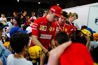 Charles Leclerc, Ferrari, signs autographs for young fans