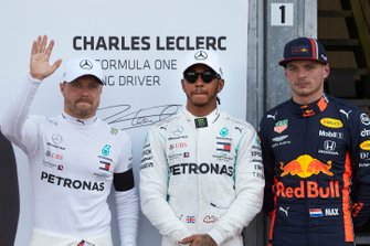 Front row starters, Valtteri Bottas, Mercedes AMG F1, and pole man Lewis Hamilton, Mercedes AMG F1, alongside Max Verstappen, Red Bull Racing