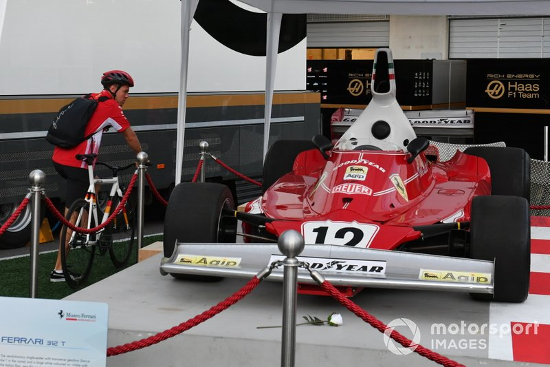 Sebastian Vettel, Ferrari looking at the Ferrari 312T of Niki Lauda on display in the paddock