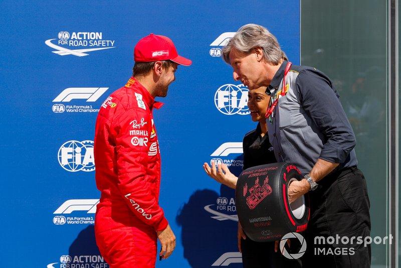 Sebastian Vettel, Ferrari, is presented with his Pirelli Pole Position Award by Roberto Boccafogli, Head of F.1 Communications, Pirelli, and actress Liza Koshy