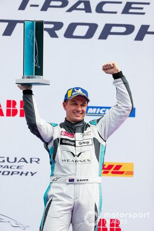 Simon Evans, Team Asia New Zealand, 3rd position, celebrates on the podium