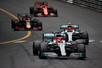Lewis Hamilton, Mercedes AMG F1 W10, leads Valtteri Bottas, Mercedes AMG W10, Max Verstappen, Red Bull Racing RB15, and Sebastian Vettel, Ferrari SF90