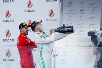 Valtteri Bottas, Mercedes AMG F1, 1st position, sprays the victory Champagne into his face