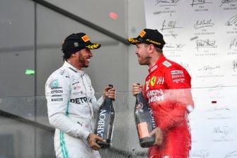 Lewis Hamilton, Mercedes AMG F1, 2nd position, and Sebastian Vettel, Ferrari, 3rd position, celebrate on the podium