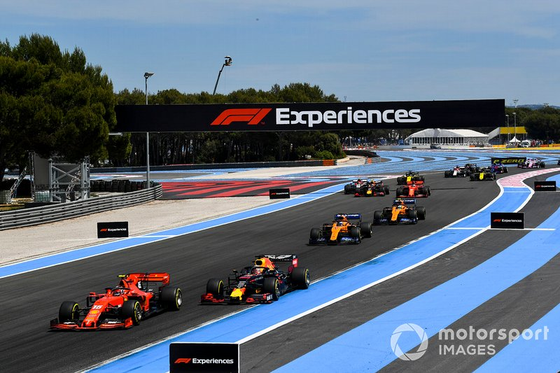 Charles Leclerc, Ferrari SF90, leads Max Verstappen, Red Bull Racing RB15, Carlos Sainz Jr., McLaren MCL34,Lando Norris, McLaren MCL34, and the remainder of the field on the opening lap