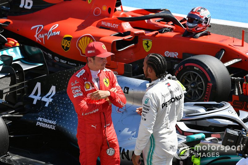 Charles Leclerc, Ferrari, talks with pole man Lewis Hamilton, Mercedes AMG F1, on the grid after Qualifying