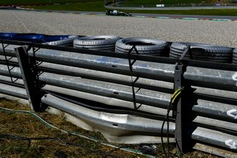 Lewis Hamilton, Mercedes AMG F1 W10, passes the damaged barrier from the crash of his team mate Valtteri Bottas, Mercedes AMG W10