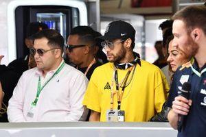 Paris St Germain and Brazil International Footballer Neymar watches the race