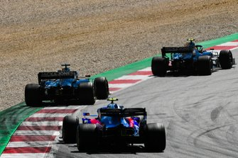 Kevin Magnussen, Haas F1 Team VF-19, leads Romain Grosjean, Haas F1 Team VF-19, and Alexander Albon, Toro Rosso STR14