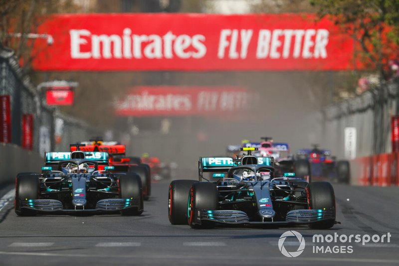Valtteri Bottas, Mercedes AMG W10 and Lewis Hamilton, Mercedes AMG F1 W10 battle on lap1