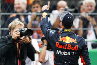 Pole man Daniel Ricciardo, Red Bull Racing, celebrates on the grid after Qualifying
