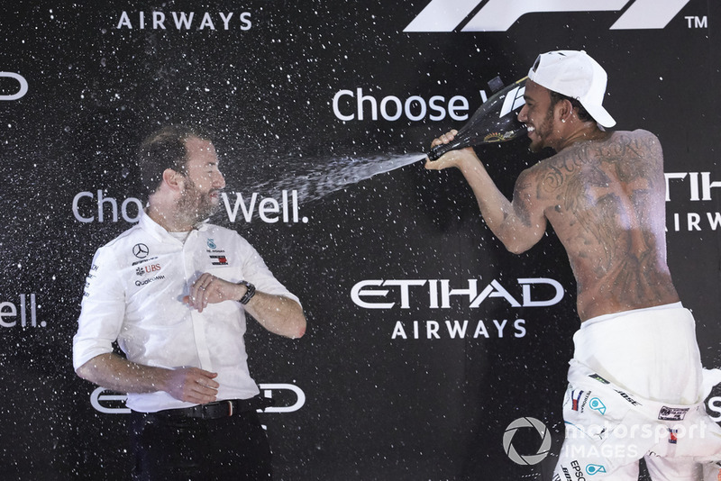 Lewis Hamilton, Mercedes AMG F1, 1st position, sprays Bradley Lord, Communications Director, Mercedes AMG, on the podium