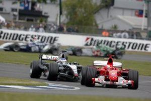 Michael Schumacher, Ferrari F2004, leads Kimi Raikkonen, McLaren Mercedes MP4/19B