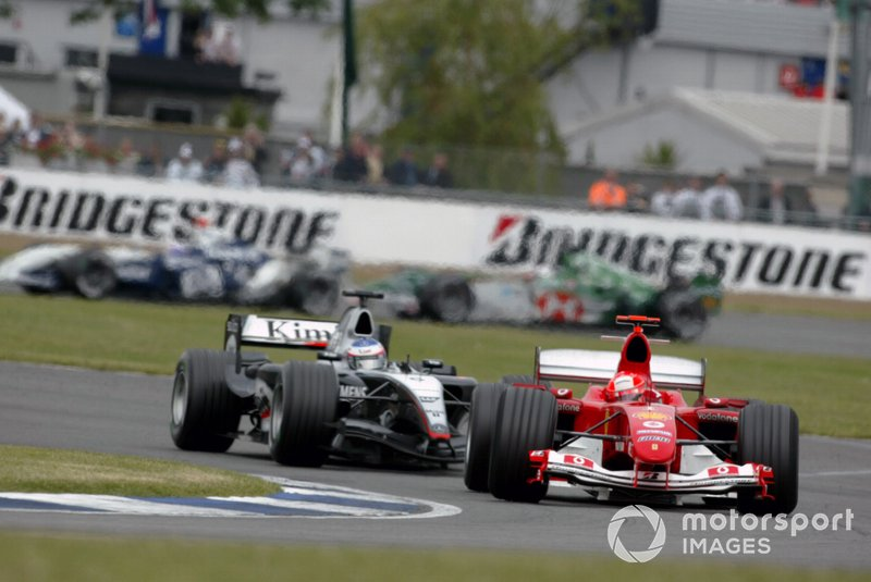 Michael Schumacher, Ferrari F2004, Kimi Raikkonen, McLaren Mercedes MP4/19B