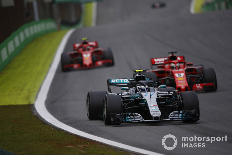 Valtteri Bottas, Mercedes AMG F1 W09 EQ Power+, leads Sebastian Vettel, Ferrari SF71H, and Kimi Raikkonen, Ferrari SF71H