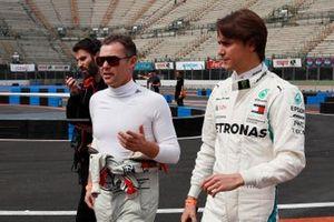 Tom Kristensen and Esteban Gutierrez walk the track