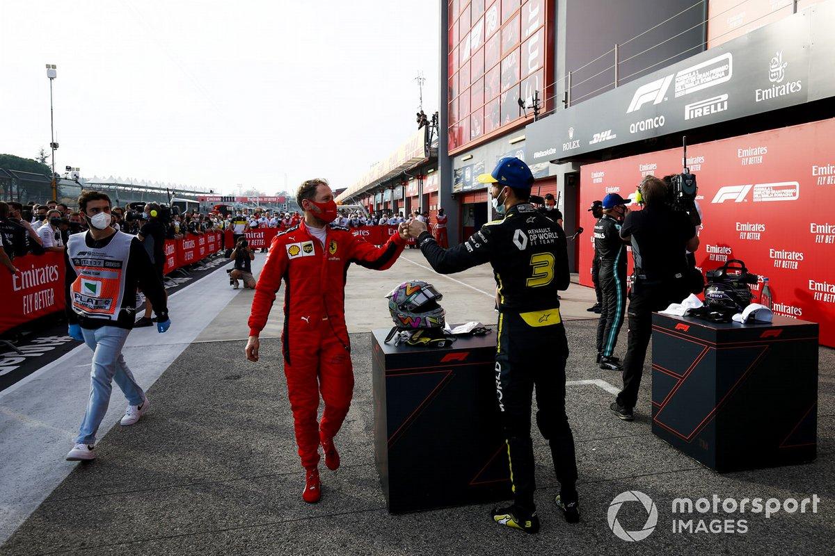 Sebastian Vettel, Ferrari e Daniel Ricciardo, Renault F1 festeggiano al Parc Ferme