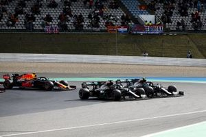 Lewis Hamilton, Mercedes F1 W11, battles with Valtteri Bottas, Mercedes F1 W11, for the lead at the start