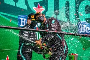 Valtteri Bottas, Mercedes-AMG F1, 2nd position, and Lewis Hamilton, Mercedes-AMG F1, 1st position, celebrate on the podium with Champagne