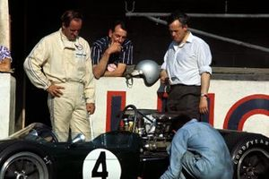 Denny Hulme and Keith Duckworth, Cosworth engine designer look at the Brabham Repco BT24 in the pits