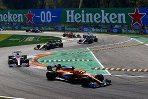 Lando Norris, McLaren MCL35, Sergio Perez, Racing Point RP20, Daniel Ricciardo, Renault F1 Team R.S.20, and Valtteri Bottas, Mercedes F1 W11, on the opening lap