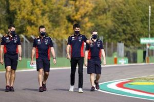 Alex Albon, Red Bull Racing, walks the track with his team