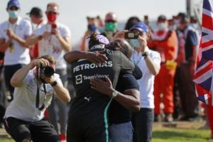 Lewis Hamilton, Mercedes, 1st position, is congratulated by his dad Anthony after the race