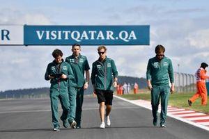 Sebastian Vettel, Aston Martin, walks the track with member so his team