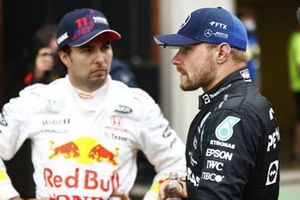 Sergio Perez, Red Bull Racing, 3rd position, and Valtteri Bottas, Mercedes, 1st position