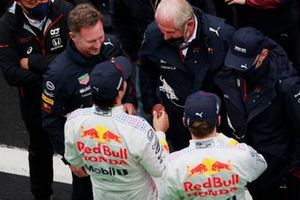 Christian Horner, Team Principal, Red Bull Racing, and Helmut Marko, Consultant, Red Bull Racing, talk with Max Verstappen, Red Bull Racing, 2nd position, and Sergio Perez, Red Bull Racing, 3rd position, after the race